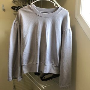 Size medium wide sleeved pullover sweatshirt